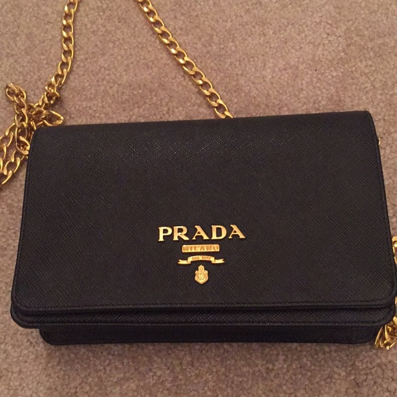 1b9e5f8d8476a5 Authentic Prada Saffiano leather wallet on a chain.  M_5a99297a3800c5431463097d